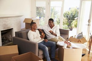 Father And Adult Son Take A Break With Pizza On Moving Day