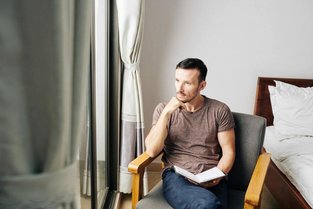 Man filling gratitude journal