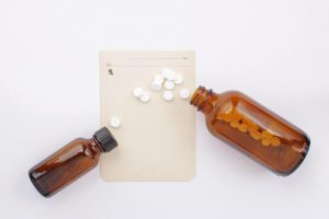 Pharmaceuticals with pills, bottles and prescription