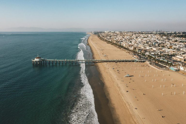 Aerial View over Manhattan Beach in California with Green Blue Water and Blue Sky near Los Angeles